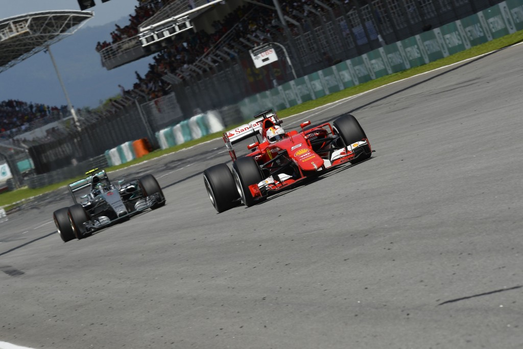 Vettel leading Mercedes in Sepang