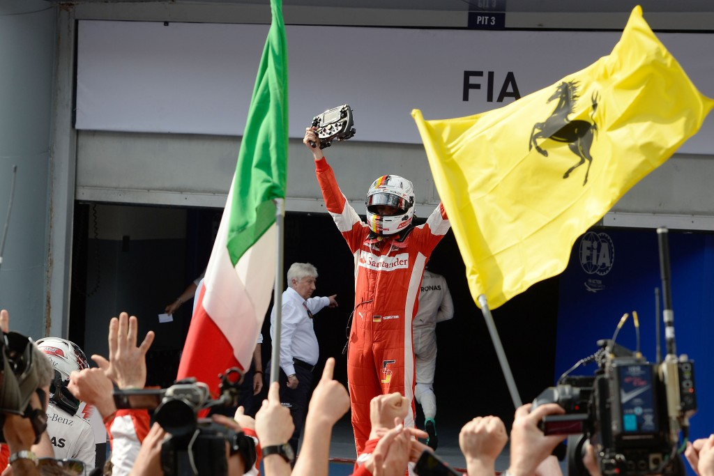 Vettel holds the Ferrari steering wheel in victory