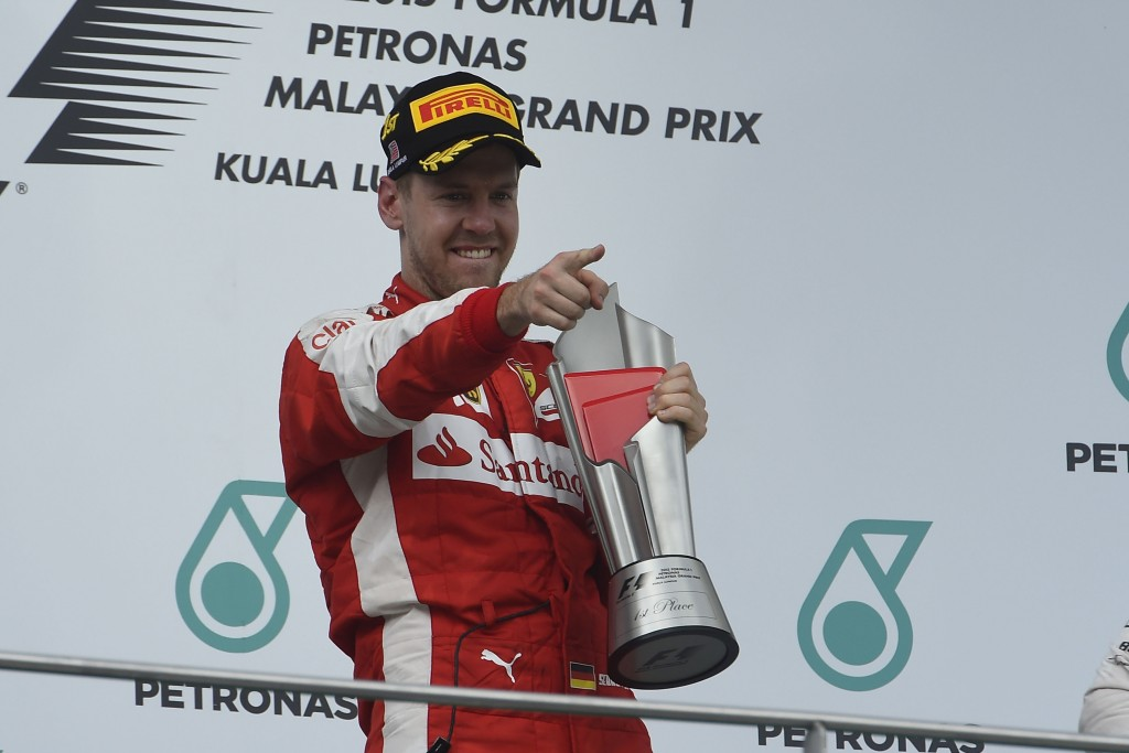 Vettel salutes the Ferrari team after winning in Malaysia