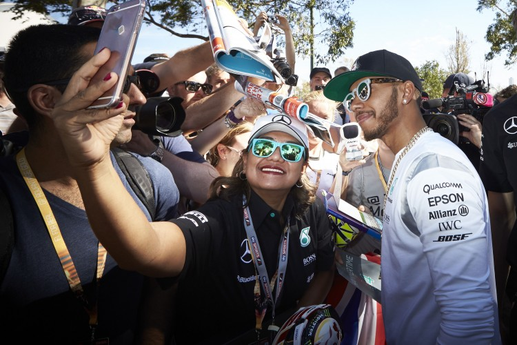Lewis Hamilton with fan in Melbourne